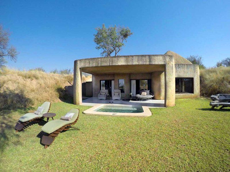 reservas privadas africa do sul: E agora nosso quarto incrível no Earth Lodge, também do Sabi Sabi: projeto inspirado numa caverna